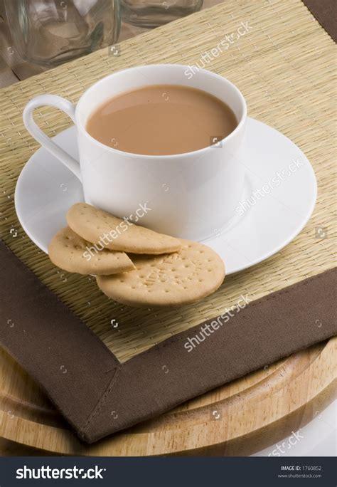 cup  tea  rich tea biscuits stock photo