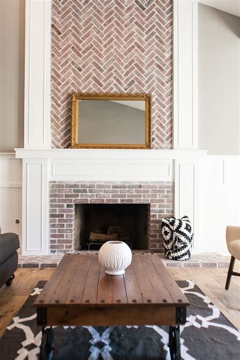 custom fireplace with herringbone brick work by
