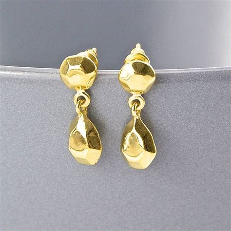 gold faceted gold faceted teardrop stud earrings by gaamaa