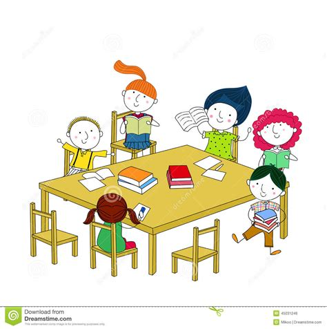 at the table children write and read sitting at the table stock