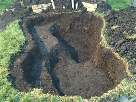 digging a backyard pond digging hole for pond in backyard landscaping lawn care