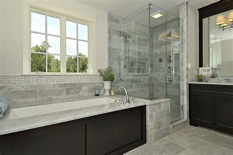 master bathroom with wall sconce complex marble in chevy