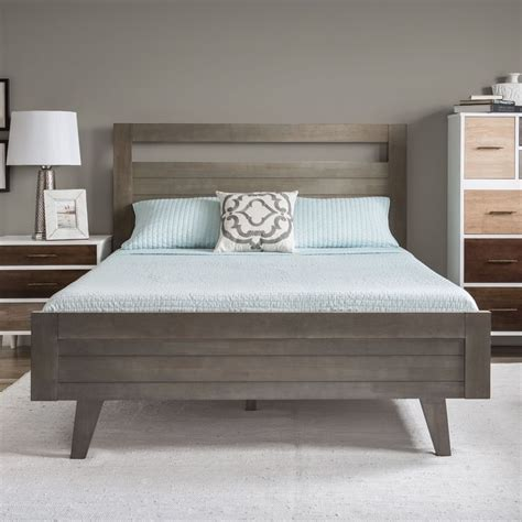the light wood stain on this stickley bedroom set and this queen sized bed features a bright butter white finish