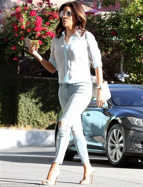 eva longoria looks expectant in blouse as she attends political eva longoria sizzles in ripped denim and a baby blue shirt