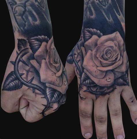 rose tattoo on hand with name black and white rose hand tattoodenenasvalencia