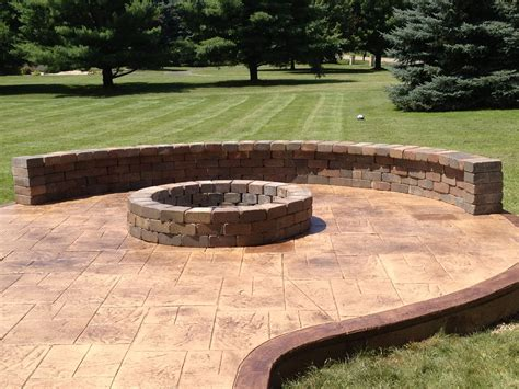 sted concrete patio with fire pit and sitting wall