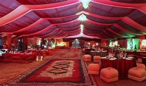 details of a garden wedding theme in arabia weddings arabian nights arabian attire bazaar tent with market items baskets ls urns rugs