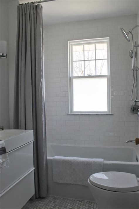 Minimalist Bathroom Decoration With White Wall And Gray Farbic Sliding Curtain And White Marble