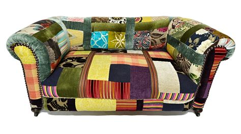 a small chesterfield sofa with patchwork