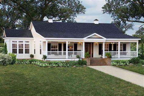 single story farmhouse with wrap around porch publizzity