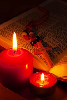 Lentera Cing open bible with cross and burning candles bible text