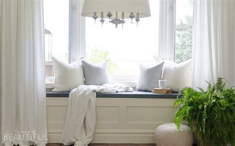 bench in front of window diy window bench with storage a burst of beautiful