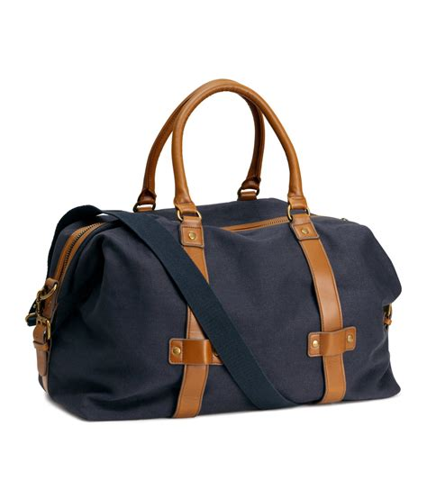 A Weekend Bag For The lyst h m weekend bag in blue for