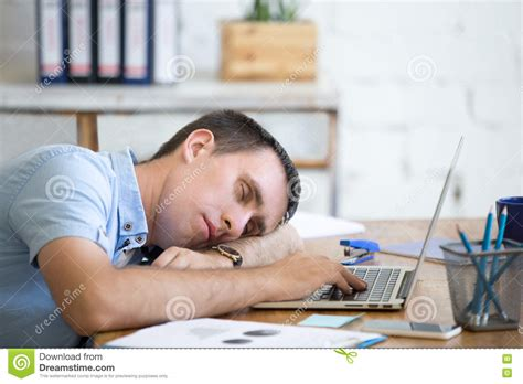 sleeping on desk sleeping on office desk stock photo image