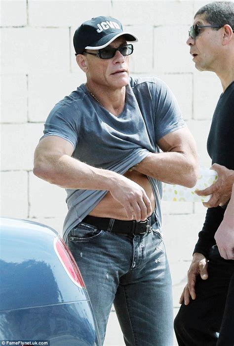 shirtless jean claude van damme displays muscular physique