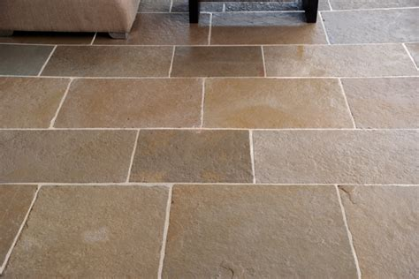 Laying Limestone Floor Tiles by Floors Of