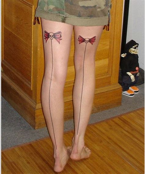 bow tattoos on back of thighs bow leg tattoos two skull bows shaped up on the