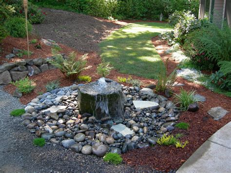 rock water features for the garden small bubbling rock water feature and plantings
