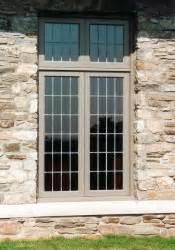 custom wood casement windows  leaded glass panels