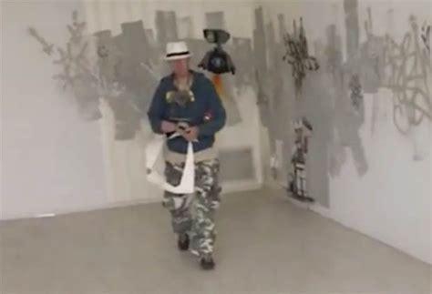 banksy unmasked elusive graffiti artist spotted  work