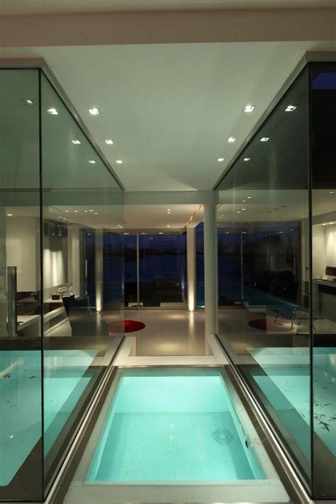lakeside black house  views pools glass bridge