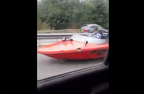 speed boat driving video car is passed on the highway by a guy driving a