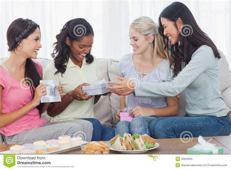couch party friends offering gifts to dark woman during party royalty