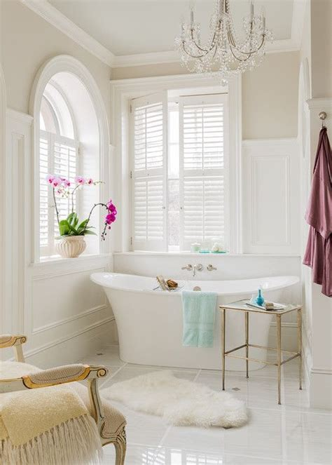 shutters in bathroom oval tub under plantation shutter windows traditional