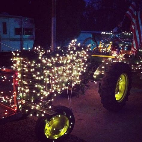 tractor christmas tree lights goin for a ride on the tractor it s ready for the day after thanksgiving parade