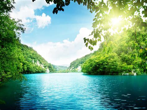 hd wallpaper blue nature sunshine between leaves green mountains hd wallpaper hd