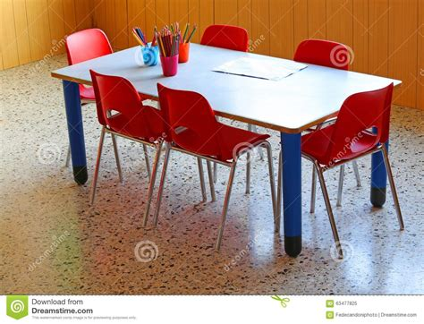 small school desk small school desk with yellow chairs in a kindergarten