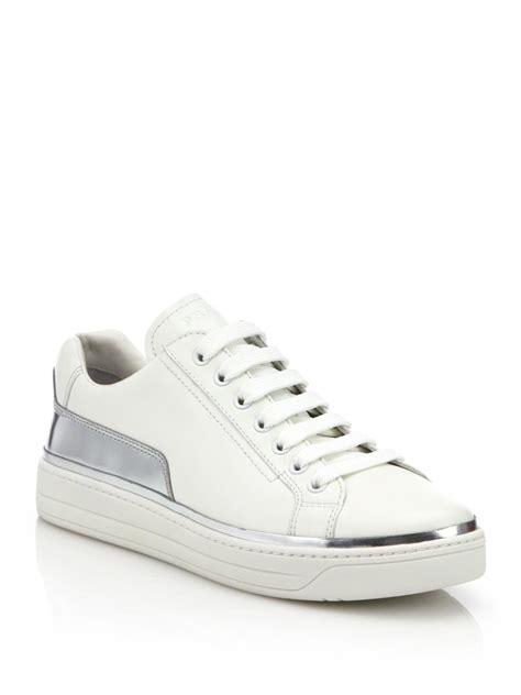 prada metallic leather trimmed leather sneakers in white