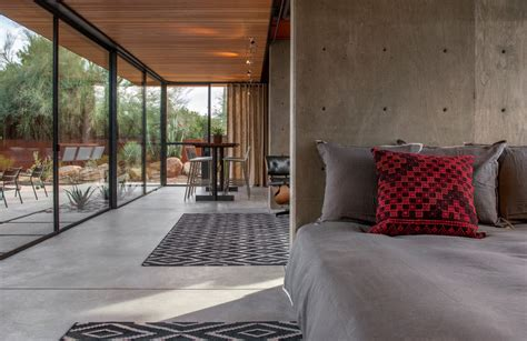 modern concrete floor finish in bedroom in camarillo ca horse barn turned into open guest house