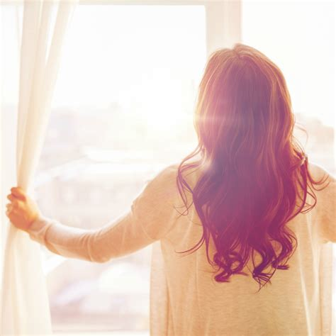 woman opening curtains home no longer empty