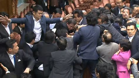 japanese fighting japan brawl erupts in parliament approval of controversial security bills