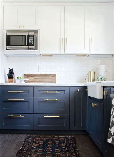 navy blue cabinet pulls white and navy cabinets brass pulls throw rug