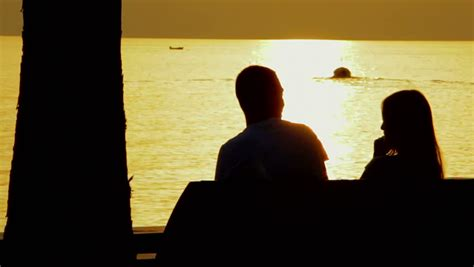 bench couple watch young couple on a bench by the sea watching the sunset stock footage video 7883620
