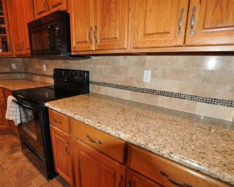 Backsplash For Black Countertops by Backsplash Ideas For Black Granite Countertops And White