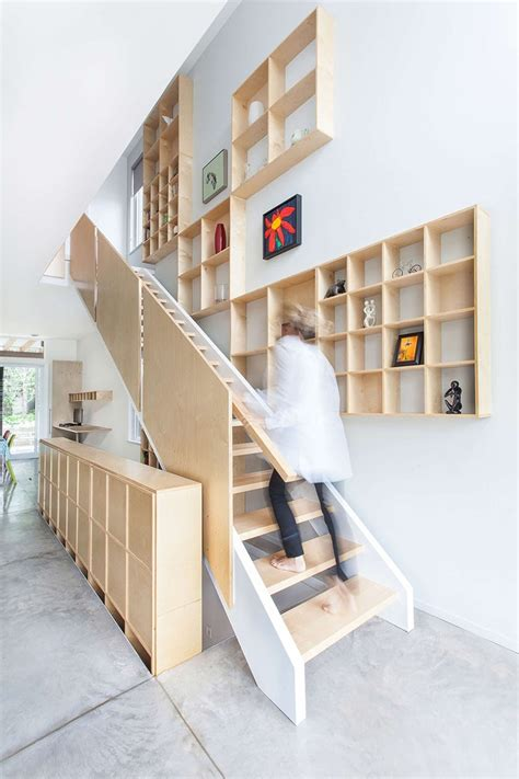 Plywood Stairs Design Design Detail A Grid Of Plywood Shelves Follow The Stairs Contemporist