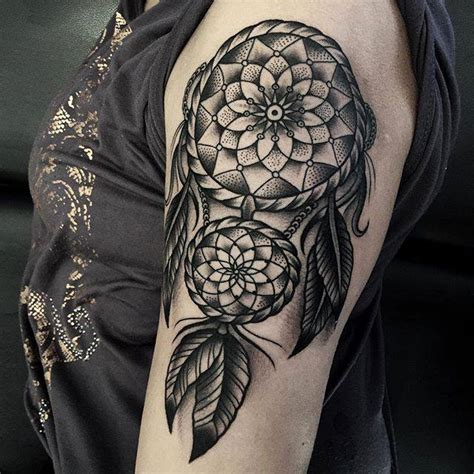 black and grey dreamcatcher tattoo on side leg