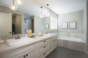 the pendant lights over bathroom sink