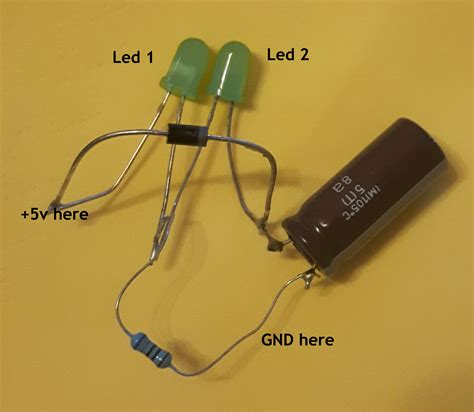 capacitor with led capacitor why both leds does not light equally when power is applied electrical engineering