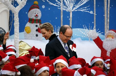 prince albert and the christmas tree princess charlene cheers up children at tree ceremony in monaco photos