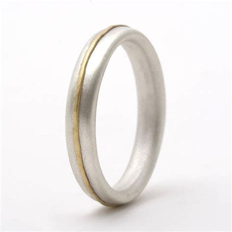 thin sterling silver ring with 18ct yellow gold detail by