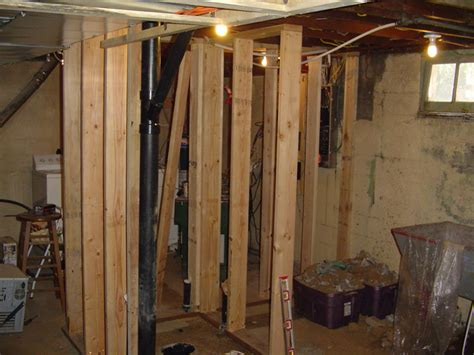building a bathroom in the basement next day after the cement dried we started to stud the