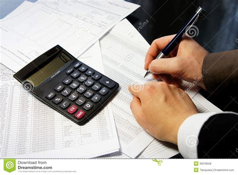 Table Calculator by Office Table With Calculator Pen And Accounting Document