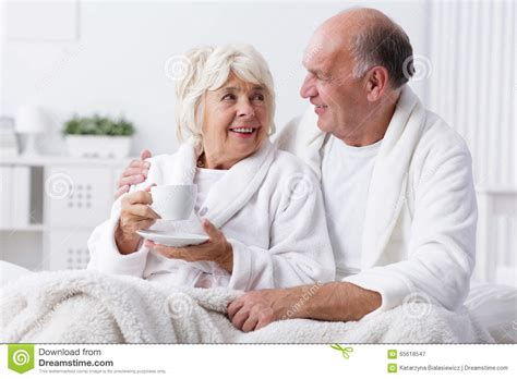lovers in bed senior lovers in bed stock photo image 65618547