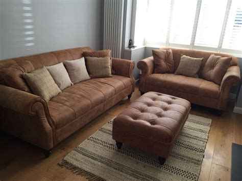 grey walls tan couch tan leather sofa grey walls natural rug living room white