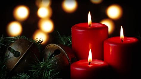looping three red christmas candles flicker alongside