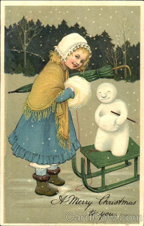 small girl  snow  sled snowmen